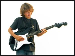 teen holding a guitar